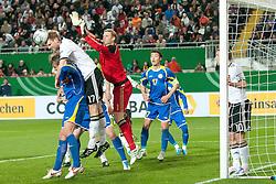 26.03.2011, Fritz-Walter Stadion, Kaiserslautern, GER, EURO 2012 Qualifikation, Deutschland (GER) vs Kasachstan, im Bild vl. Anton Chiculin (Kasachstan #6), Per Mertesacker (Deutschland #17 Werder Bremen), Manuel Neuer (Deutschland #1 FC Schalke), Kairat Nurdauletov (Kasachstan #17), Lukas Podolski (Deutschland #10 1. FC Koeln), EXPA Pictures © 2011, PhotoCredit: EXPA/ nph/  Roth       ****** out of GER / SWE / CRO  / BEL ******