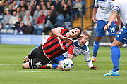 Shrewsbury Town Midfielder, Louis Dodds (10) is tackled by Bury Defender, Niall Maher (22) during the EFL Sky Bet League 1 match between Bury and Shrewsbury Town at the JD Stadium, Bury, England on 10 September 2016. Photo by Mark Pollitt.