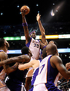 Dec. 17, 2012; Phoenix, AZ, USA; Phoenix Suns center Jermaine O'Neal (20) puts up the ball in traffic during the game against the Sacramento Kings in the second half at US Airways Center. The Suns defeated the Kings 101-90.  Mandatory Credit: Jennifer Stewart-USA TODAY Sports
