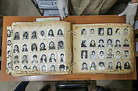 """A police album containing names and faces of government labelled """"delinquents"""". Each photo inside represents a person who was processed by the former Guatemalan National Police. Many were later killed or disappeared during the civil war. Archivo Histórico de la Policía Nacional - Guatemala City"""