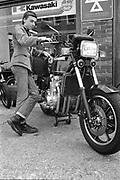 Symond with Kawasaki motorbike. UK. 1980s.