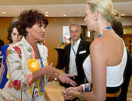(L) Jolanta Kwasniewska - Former First Lady of Poland & (R) Princess Charlene of Monaco, wife of Monaco's Prince Albert II while 2011 Special Olympics World Summer Games Athens on June 25, 2011..The idea of Special Olympics is that, with appropriate motivation and guidance, each person with intellectual disabilities can train, enjoy and benefit from participation in individual and team competitions...Greece, Athens, June 25, 2011...Picture also available in RAW (NEF) or TIFF format on special request...For editorial use only. Any commercial or promotional use requires permission...Mandatory credit: Photo by © Adam Nurkiewicz / Mediasport