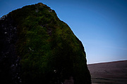 Maen Llia, an ancient standing stone in the Llia valley, Brecon Beacons, Powys, South Wales. The stone is a massive sandstone block which stands 3.7m high. It is roughly diamond-shaped and is partly moss-covered. Its age and original purpose are unknown though it is thought to date from the Bronze Age. It is a popular tourist attraction run by Brecon Beacons National Park.  (photo by Andrew Aitchison / In pictures via Getty Images)