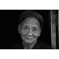 Portrait of an old woman in Hoi An