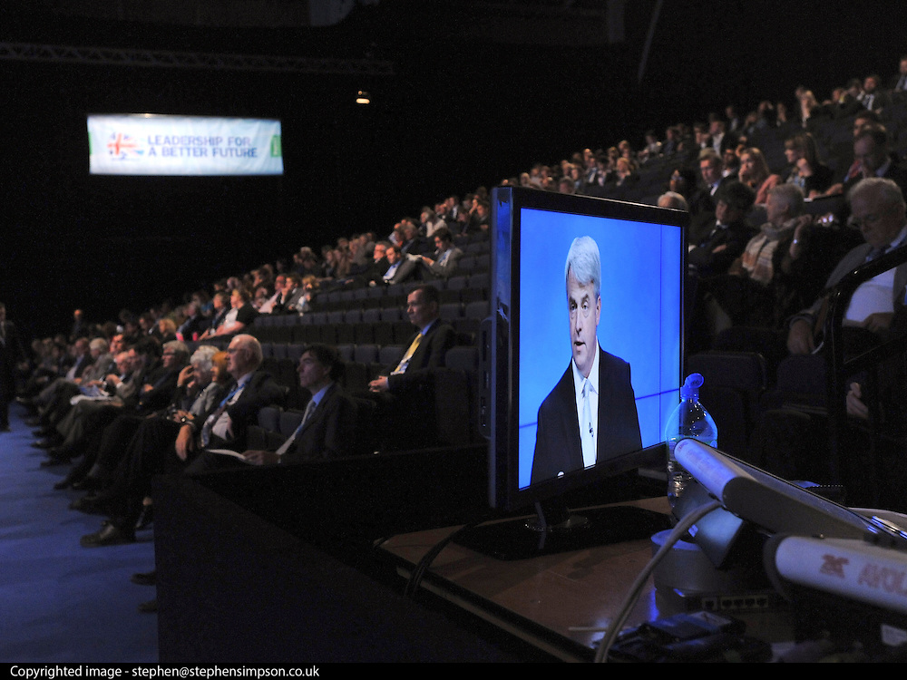© Licensed to London News Pictures. 04/10/2011. MANCHESTER. UK. The Rt Hon Andrew Lansley CBE MP, Secretary of State for Health appears on a television monitor in the auditorium as he addresses The Conservative Party Conference at Manchester Central today, October 4, 2011. Photo credit:  Stephen Simpson/LNP