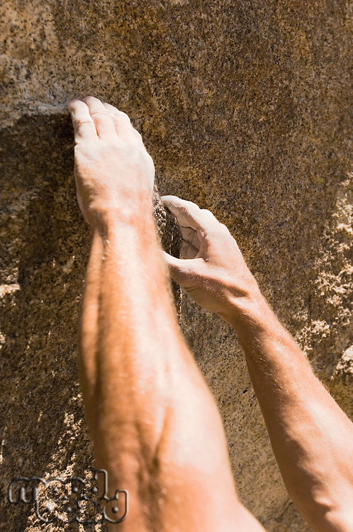 Hands and Arms Climbing Rock