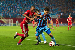 TRABZON, TURKEY - Thursday, August 26, 2010: Liverpool's David Ngog in action against Trabzonspor's Egemen Korkmaz during the UEFA Europa League Play-Off 2nd Leg match at the Huseyin Avni Aker Stadium. (Pic by: David Rawcliffe/Propaganda)
