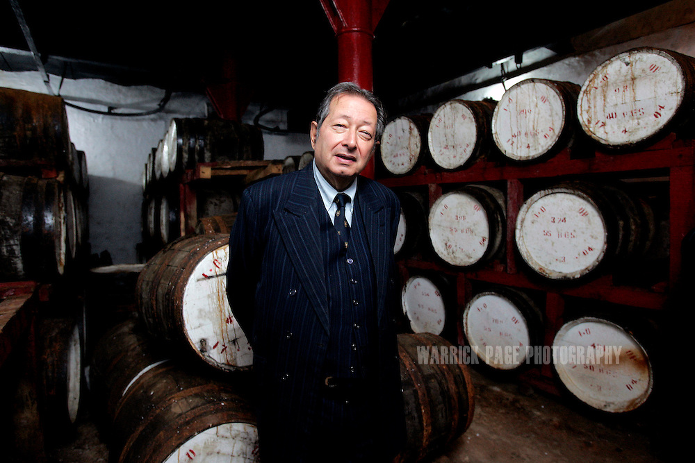 Managing Director of Murree Brewery, Minoo Bhandara, stands amongst barrels of malt whiskey, Wednesday, February 14, in Rawalpindi, Pakistan.The brewery boasts the first 20 year-old malt whiskey in the Muslim world, due for release in mid-2007. Established more than a century ago under British Raj, Murree Brewery also is Pakistan's oldest company and one of two breweries in a country under prohibition. Muslims have been banned from drinking alcohol since it was outlawed in 1977, but Christians and Hindus may still buy alcohol. The brewery hopes to export the exclusive whiskey to Europe and the Middle East. (Photo by Warrick Page)