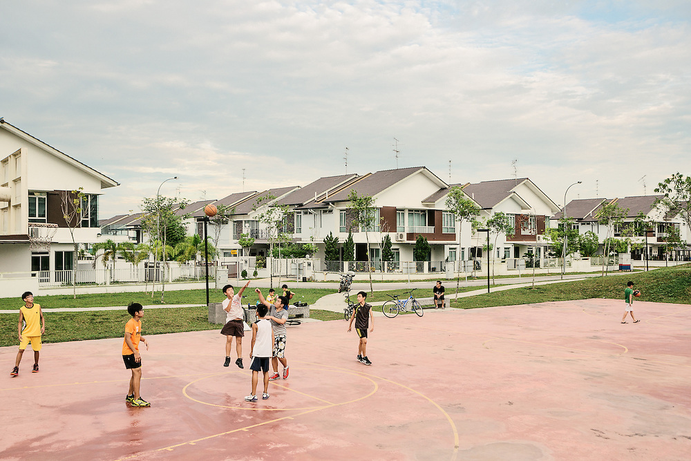 Children playing in a communal playground in the Horizon Hills Development, a gated community in Iskandar Malaysia. The area is part of the five flagship zones that have been undergoing massive changes in Ithe skandar region. Iskandar Malaysia (IM), formerly known as Iskandar Development Region (IDR) and South Johor Economic Region (SJER) is the main southern development corridor in Johor, Malaysia. The Iskandar Malaysia was established on 30 July 2006. The project is administered by Iskandar Regional Development Authority (IRDA) and was named after the late Sultan of Johor, Almarhum Sultan Iskandar. The economic growth plan of the CDP consists of two components, a Strategic Economic Thrust (SET) for immediate implementation and a Future Growth Scenario, 2005-2025, for long-term application. Both of these were developed in mind of the region's economic strengths in manufacturing and services, with 60% of value-added manufacturing derived from electrical and electronic (E&E), chemical and chemical products (petrochemical, plastics, oleo chemicals) and food processing sub-sectors. A number of service and other manufacturing areas have emerged in support of these. The SET focuses on such factors as strengthening existing economic sectors and encouraging diversity, through incentives, stronger international ties, and proper allocation of resources and space. The Future Growth Scenario is aimed towards strengthening the economy internally and internationally by such factors as improvements in global transportation and developing manufacturing and service clusters. Also promoted by the Future Growth Scenario is the encouragement of the immigration of skilled, monied foreigners to help develop an international lifestyle attractive to foreign workers and investors. The targeted foreign and local investments for the IM is US$ 100 billion.