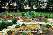 63821-06618 Newly mulched and planted flower garden in early spring with  bird bath,  Marion Co. IL