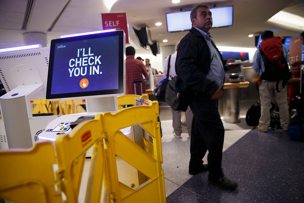New JetBlue check-in kiosks stand surrounded by barriers as passengers check in for Delta Flights in Terminal 5 as the airline relocation begins at Los Angles International Airport (LAX) on Friday, May 12, 2017 in Los Angeles, Calif. Delta Airlines will move from Terminals 5 and 6 to Terminals 2 and 3, forcing 19 other carriers to shift their operations into the facilities vacated by Delta.  © 2017 Patrick T. Fallon