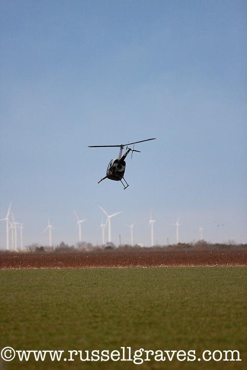 MULE DEER RESEARCH HELICOPTER FLYING OVER TEXAS RANGELANDS