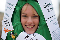 © Licensed to London News Pictures. 26/04/2013. London, UK. Protester dressed as tree stage a demonstration in Parliament Square, London on April 26, 2013. Over 100 beekeepers  from across the UK march on Parliament in opposition to the Government's plan to oppose a ban on bee killing pesticides in a crucial EU vote on Monday. Photo credit : Peter Kollanyi/LNP