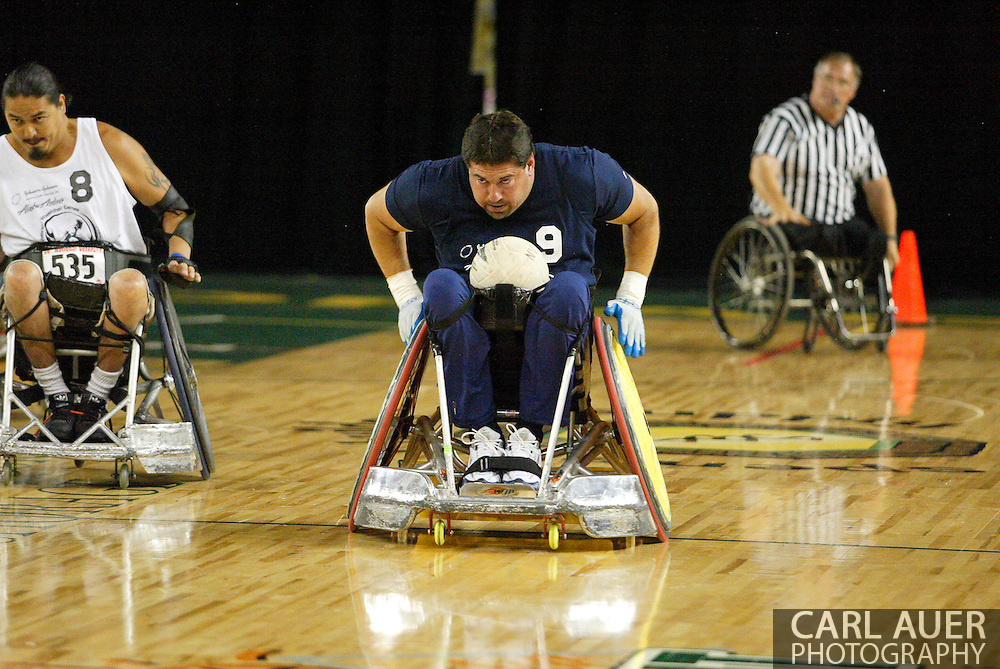 July 7th, 2006: Anchorage, AK - Scot Severn (9) speeds down the floor to score with Arron Powless (8) giving chase as White defeated Blue in the gold medal game of Quad Rugby at the 26th National Veterans Wheelchair Games.