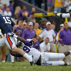 October 22, 2011; Baton Rouge, LA, USA; LSU Tigers defensive lineman Jermauria Rasco (59) sacks Auburn Tigers quarterback Clint Moseley (15)during the second half at Tiger Stadium. LSU defeated Auburn 45-10. Mandatory Credit: Derick E. Hingle-US PRESSWIRE / © Derick E. Hingle 2011