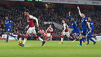 Football - 2017 / 2018 Premier League - Arsenal vs. Everton<br /> <br /> Pierre-Emerick Aubameyang (Arsenal FC) prepares to chip the ball over the on rushing Jordan Pickford (Everton FC ) as Everton defenders stand still appealing for offside at The Emirates.<br /> <br /> COLORSPORT/DANIEL BEARHAM