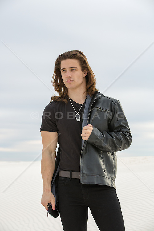 man with long brown hair outdoors in White Sands, New Mexico