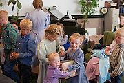 "Aug 10, 2008 -- COLORADO CITY: Children in the Jessop family hand out candy after a prayer service in their living room. The Jessops are polygamists and members of the FLDS. Colorado City and neighboring town of Hildale, UT, are home to the Fundamentalist Church of Jesus Christ of Latter Day Saints (FLDS) which split from the mainstream Church of Jesus Christ of Latter Day Saints (Mormons) after the Mormons banned plural marriage (polygamy) in 1890 so that Utah could gain statehood into the United States. The FLDS Prophet (leader), Warren Jeffs, has been convicted in Utah of ""rape as an accomplice"" for arranging the marriage of teenage girl to her cousin and is currently on trial for similar, those less serious, charges in Arizona. After Texas child protection authorities raided the Yearning for Zion Ranch, (the FLDS compound in Eldorado, TX) many members of the FLDS community in Colorado City/Hildale fear either Arizona or Utah authorities could raid their homes in the same way. Older members of the community still remember the Short Creek Raid of 1953 when Arizona authorities using National Guard troops, raided the community, arresting the men and placing women and children in ""protective"" custody. After two years in foster care, the women and children returned to their homes. After the raid, the FLDS Church eliminated any connection to the ""Short Creek raid"" by renaming their town Colorado City in Arizona and Hildale in Utah.     Photo by Jack Kurtz / ZUMA Press"