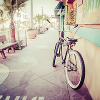 Retro photo of California beach crusier bike in Newport Beach California. Taken at Cabo Cantina on Main Street on Balboa Peninsula in Orange County Southern California. Image Copyright © Paul Velgos All Rights Reserved.