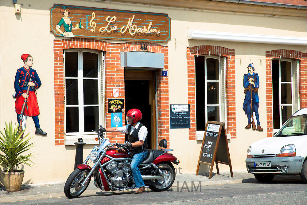 Man on Harley Davidson motorbike at Bar La Madelon on the Champagne Tourist Route at Mancy, Champagne-Ardenne, France