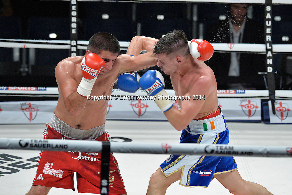 Martin Joseph Ward (blue shorts) defeats Kakhaber Avetisian in a Lightweight contest at the SSE Wembley Arena, London on the 20th September 2014. Sauerland Promotions. Credit: Leigh Dawney Photography.