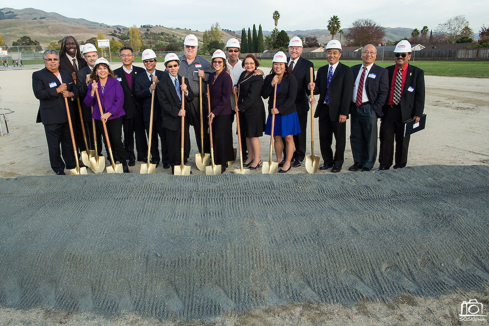 Dignitaries pose for a portrait during the Milpitas Unified School District and San Jose Evergreen Community College District Community College Extension Ground Breaking Ceremony near Russell Middle School in Milpitas, California, on November 17, 2015. (Stan Olszewski/SOSKIphoto)