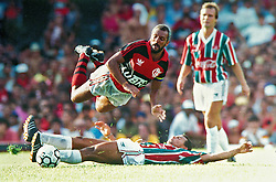 Rio de Janeiro, RJ, Brasil   15/Dec/1991.Primeiro Jogo da decisao do Campeonato Carioca, Fla 1 x 1 Flu. Junior, do Fla foge de falta do tricolor./ First game of the decision of Rio de Janeiro championship, Flamengo X Fluminense. Junior, Flamengo player..Foto Marcos Issa/Argosfoto