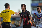 Stefan Ratchford (1) of Warrington Wolves speaks with referee Marcus Griffiths during the Betfred Super League match between Wakefield Trinity Wildcats and Warrington Wolves at Belle Vue, Wakefield, United Kingdom on 16 February 2020.