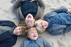 four children enjoying time together on the beach in The Fall