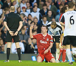 LONDON, ENGLAND - Saturday, October 31, 2009: Liverpool's Jamie Carragher desputes the referee's decision after being unfairly sent-off against Fulham during the Premiership match at Craven Cottage. (Pic by David Rawcliffe/Propaganda)
