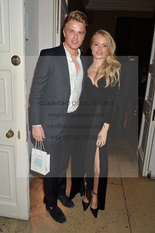 HENRY FISHER and CHARLIE NEWMAN at the Tatler Little Black Book Party held at Home House Private Member's Club, Portman Square, London supported by CARAT on 6th November 2014.