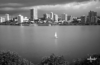 Condado lagoon with sunfish sailing in the middle