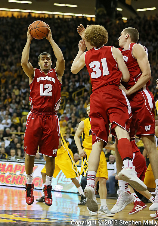 January 19 2013: Wisconsin Badgers guard Traevon Jackson (12) pulls down a rebound during the first half of the NCAA basketball game between the Wisconsin Badgers and the Iowa Hawkeyes at Carver-Hawkeye Arena in Iowa City, Iowa on Sautrday January 19 2013. Iowa defeated Wisconsin 70-66.
