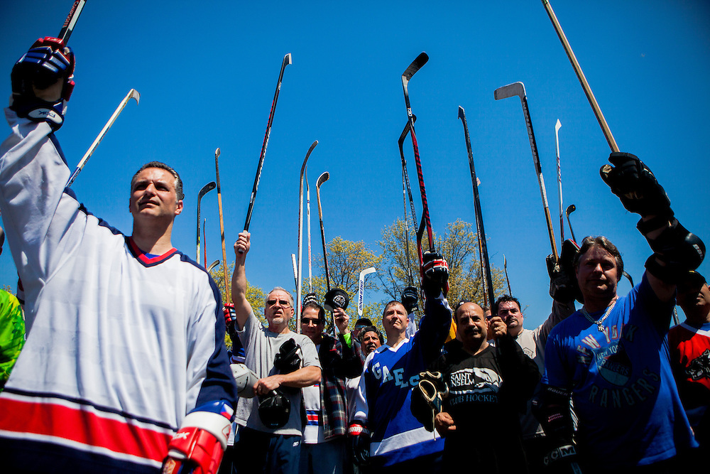 QUEENS, NY - MAY 2, 2015: Players hoist their sticks to pay tribute to Craig Allen, a former teammate and opponent to many of those assembled at an annual reunion of old-time street hockey players in Long Island City. Allen died unexpectedly last week just days before the tournament. CREDIT: Sam Hodgson for The New York Times