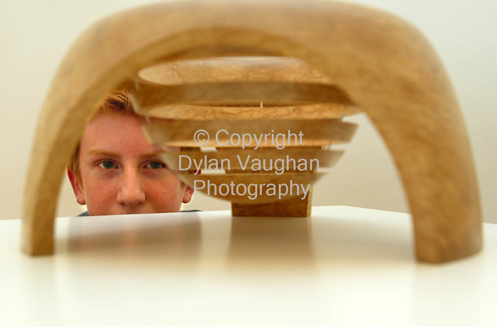 10/11/2002.Free picture No Charge.Pictured at the opening Splanc Exhibition of woodturning at the Crafts Council of Irelands National Crafts Gallery in Kilkenny over the weekend was fourteen year old woodturner Charlie Watt from Carrickfergus County Antrim with an examples of his work..Picture Dylan Vaughan