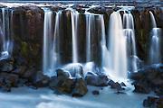 Selfoss is a waterfall in the river Jökulsá á Fjöllum in the north of Iceland which drops over some waterfalls about 30 km before flowing into Öxarfjörður, a bay of the Arctic Sea   Selfoss er en foss i nord Island i elven Jökulsá á Fjöllum, som strekker seg ca 30 kilometer før den renner ut i fjorden Öxarfjörður i Ishavet.