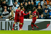 Mohamed Salah (#11) of Liverpool celebrates Liverpool's second goal (1-2) with Liverpool team mates during the Premier League match between Newcastle United and Liverpool at St. James's Park, Newcastle, England on 4 May 2019.