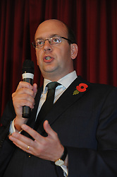 © Licensed to London News Pictures. 04/11/2014<br /> Mark Reckless talking.<br /> UKIP Leader Nigel Farage Joins the party's Rochester and Strood By-election candidate Mark Reckless at a public meeting at The Hoo Village Institute Hoo St Werburgh, Rochester,Kent.<br /> (Byline:Grant Falvey/LNP)