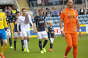 Dundee captain Kevin Thomson and mascot Cameron Irvine lead out Dundee for their first SPFL Premiership match of the season. Cameron's grandad Andy Irvine played for Dundee from 1946 to 1957 before moving to Falkikr where he was part of the team that defeated Killie in the Scottish Cup Final - Dundee v Kilmarnock - SPFL Premiership at Dens Park<br /> <br />  - &copy; David Young - www.davidyoungphoto.co.uk - email: davidyoungphoto@gmail.com