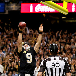 Dec 29, 2013; New Orleans, LA, USA; New Orleans Saints quarterback Drew Brees (9) dunks over the goal post following a touchdown run against the Tampa Bay Buccaneers during the fourth quarter of a game at the Mercedes-Benz Superdome.The Saints defeated the Buccaneers 42-17. Mandatory Credit: Derick E. Hingle-USA TODAY Sports