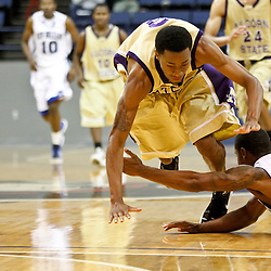 November 27, 2011; New Orleans, LA; New Orleans Privateers guard Brandon Knight (0) and Alcorn State Braves guard JaMichael Hawkins (3) scramble for a loose ball during the second half of a game at the Lakefront Arena. New Orleans defeated Alcorn St. 63-56. Mandatory Credit: Derick E. Hingle-US PRESSWIRE