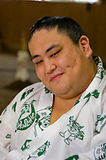 Takeuchi Masato, a professional sumo wrestler whose ring name is Miyabiyama (meaning Graceful Mountain), after practice with his team in Tokyo, Japan.  (Takeuchi Masato is featured in the book What I Eat, Around the World in 80 Diets.) MODEL RELEASED.