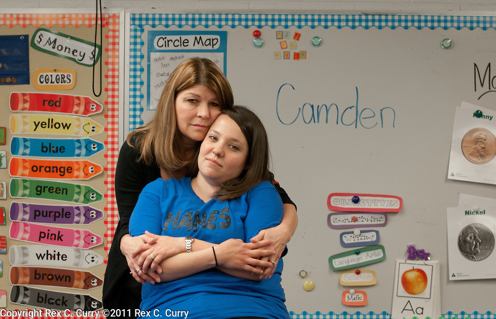 Brenda Bingham, left, principal at W.T Hanes Elementary School and Whitney Bruno, the kindergarten teacher of Camden Pierce Hughes who's mother has been charged with his murder.  HIs name was on the board while they drew pictures for him during class.