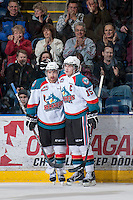 KELOWNA, CANADA - JANUARY 24: Dylen McKinlay #19 and Colton Sissons #15 of the Kelowna Rockets celebrate a goal against the Seattle Thunderbirds at the Kelowna Rockets on January 24, 2013 at Prospera Place in Kelowna, British Columbia, Canada (Photo by Marissa Baecker/Shoot the Breeze) *** Local Caption ***