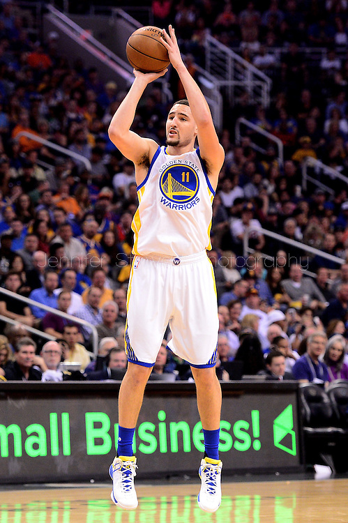 Feb 10, 2016; Phoenix, AZ, USA; Golden State Warriors guard Klay Thompson (11) shoots the ball against the Phoenix Suns at Talking Stick Resort Arena. The Golden State Warriors won 112-104. Mandatory Credit: Jennifer Stewart-USA TODAY Sports