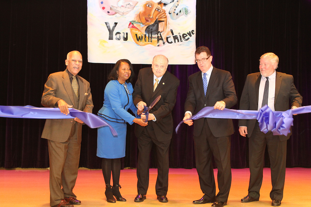 HISD Trustee Larry Marshall, from left, Principal Joyce Williams, Billy Reagan, HISD Superintendent Terry Grier, and Chief School Officer Chip Zullinger cut the ribbon on the new Billy Reagan K-8 Educational Center at the school's dedication ceremony on Wednesday, Jan. 16.<br /> To submit photos for inclusion in eNews, send them to hisdphotos@yahoo.com.