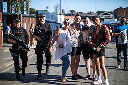 © Licensed to London News Pictures . 25/08/2019. Manchester, UK. Armed police patrol the venue as fans of Ariana Grande and other musical acts gather at Mayfield Depot ahead of performances this evening . Manchester's annual Gay Pride festival , which is the largest of its type in Europe , celebrates LGBTQ+ life . Photo credit: Joel Goodman/LNP