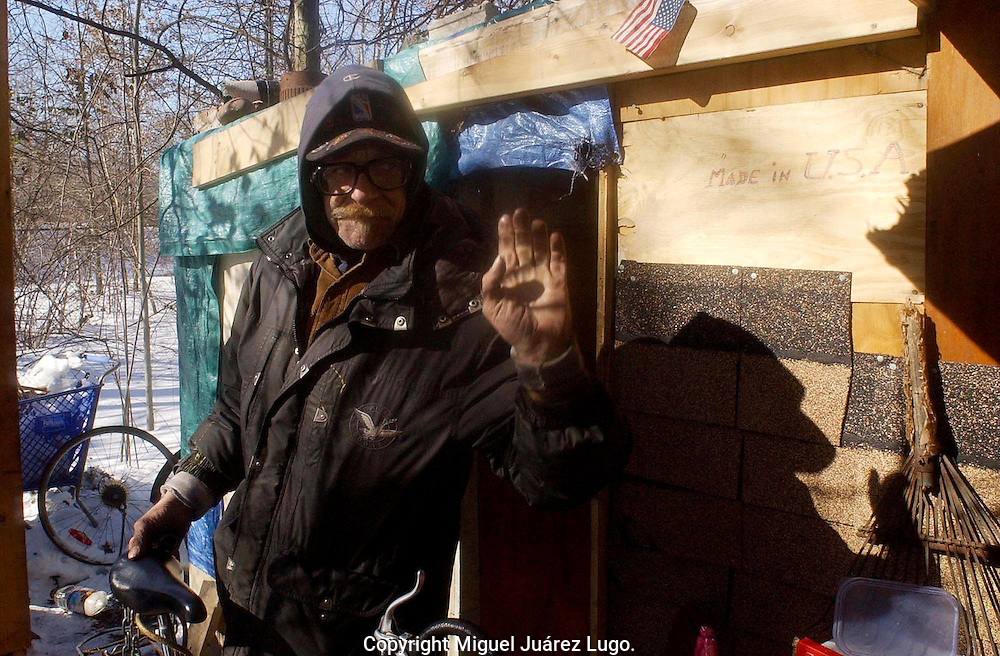 WOODBRIDGE NJ.-. Herbie, a homeless person of the encampment behind supermarket on New Brunswick Ave. Woodbridge New Jersey, pays a last look to his house with sadness as police wait to help him with a ride and an apointment to the Local Mental Health Center. (Photo by Miguel Juárez Lugo)