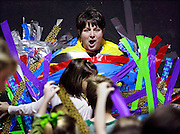 Central Elementary School principal Lydia Wilson reacts as her students tape her to the wall, as part of a reward for the students reaching their reading goals for the year in Bixby, OK.