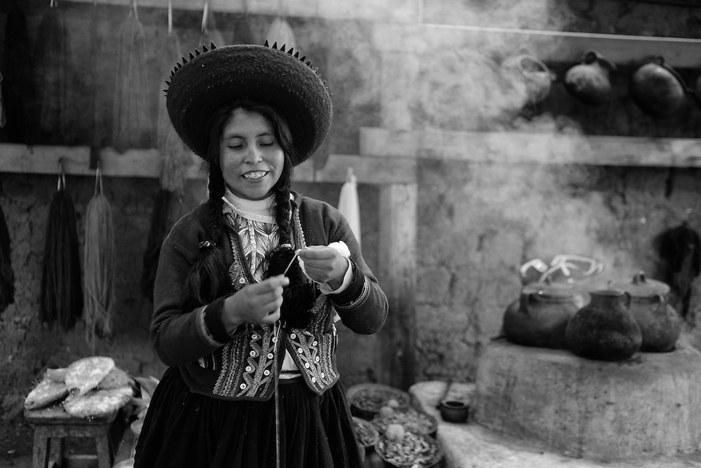 South America; Peru;Cusco,Museo de los pueblos de Paucartambo, native culture museum, woman kitting
